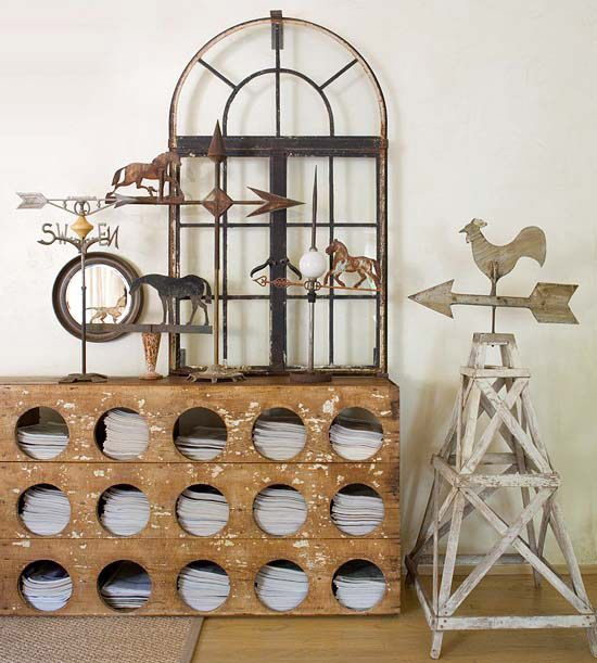 A chicken feeder makes for a perfect console table to hold magazines and display a collection of weather vanes