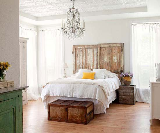 Vintage crates create instant storage in a bedroom