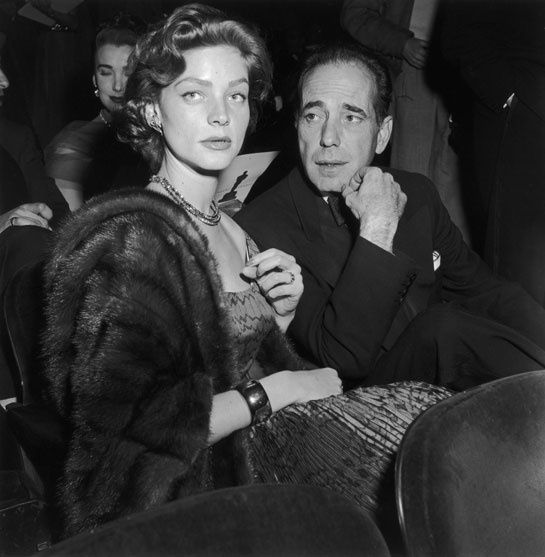 Lauren Bacall, in the Pantomime dress from the Dior Spring/Summer 1951 collection and her husband Humphrey Bogart at the 1952 Oscars