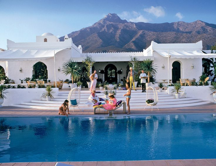 Guests lounging poolside at El Venerol, villa of Hector and Chico de Ayala, Marbella, Spain, 1967