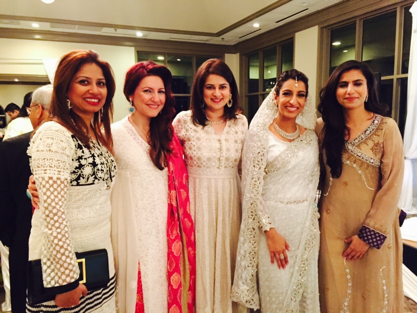 Friends posing with the Beautiful Bride in White